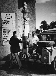 Land Rover — George Rodger Filling up before crossing the Desert, Algerian Sahara 1957 Land Rover Serie 1, Land Rover Defender 110, Defender 90, Landrover Defender, Range Rover Off Road, Man Of Mystery, Adventure Car, Best 4x4, Range Rover Classic