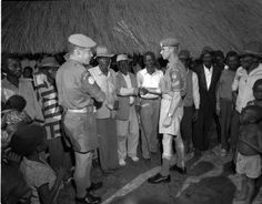 Canadian Armed Forces members visit a Congolese village in the 1960's as part of a humanitarian mission.