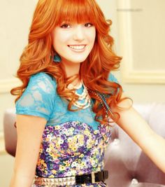Bella Thorne sitting on the chair for her photoshoot