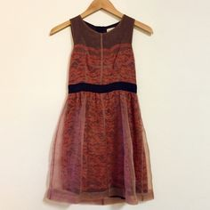 NWOT Anthropologie Petite Dress Only worn once (seen in picture) beautiful layered polyester/lace Lili Wang dress from Anthropologie. Rusty red/orange lace with overlay. Zip up the back, great and flattering fit with black waist band. Dry clean. Excellent condition! Offers welcome. Anthropologie Dresses