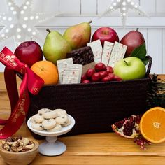 Our 2017 Festive Treats Fruit Basket has something special in it for everyone: nuts, cookies, peppermint bark, citrus, pears and a variety of apples.