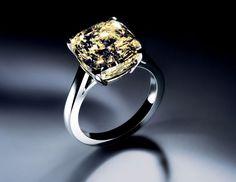 This De Beers 5.11-carat radiant cut yellow diamond ring, set in platinum, costs $400,000