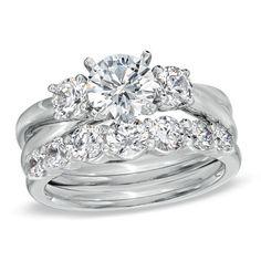 2-1/2 CT. T.W. Diamond Three Stone Criss-Cross Bridal Set in 14K White Gold   My God! $17,399
