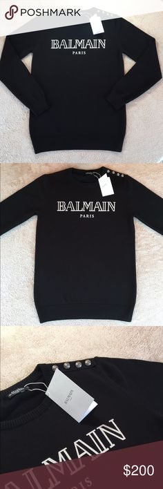 Balmain Sweater Black 100% cotton sweater from Balmain.  *Silver embossed buttons along the shoulder.  *White Balmain Logo  *It runs one size smaller Balmain Sweaters Crew & Scoop Necks