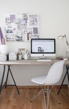 Great wood desk- perfect mix of warm wood and sleek iron legs.  Silver metallic accents enhance the modern vibe of the space.