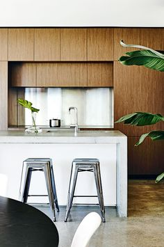 Gorgeous clean lined bamboo cabinets and waterfall island counter--image via A House in the Hills