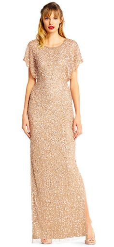 This sparkling number will stun at every gala or formal wedding. Featuring a circle neckline, fluttering sleeves, and a fitted silhouette, this beaded gown is unforgettable. A small slit at the side of the skirt adds a sultry touch and makes moving in this dress easy. This evening dress has a hidden zipper closure at the back. Paired with a matching high heel, this dress is complete.