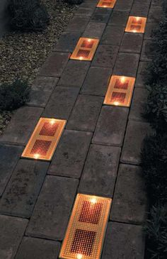 Sun Bricks compliment or replace traditional low-level patio lighting with these flush-to-the ground patio pavers. Alternate Sun Bricks with traditional patio bricks to add nighttime safety and atmosphere to your home. Solar powered LED technology means n Solar Patio Lights, Patio Lighting, Lighting Ideas, Lighting System, Sidewalk Lighting, Walkway Lights, Exterior Lighting, Lighting Design, Backyard Patio