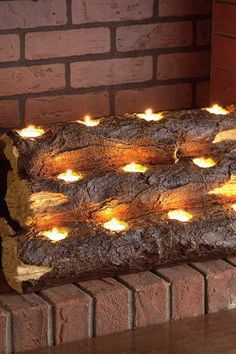 Warm Up: Fireplaces For Every Style Tealight Fireplace Log $59.00 118.00  50% off Tealight Fireplace Log by Southern Enterprises Inc