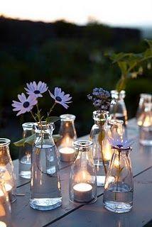 Glazen melkflesjes - milk bottles zijn ook leuk te gebruiken als vaasjes. Www.babyshopathome.nl/feest