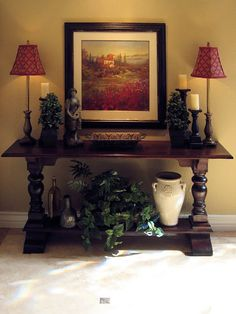 I like the symmetry on the top of this hall table, and then the mixing of decor on the bottom shelf.