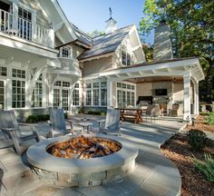 Lake House Interior Ideas Lake House With a Classic Coastal Feel - This amazing Backyard features a large stone patio with a natural Bluestone fire pit, an outdoor Fireplace and outdoor Kitchen! Fire Pit Backyard, Backyard Patio, Backyard Landscaping, Landscaping Ideas, Backyard Fireplace, Backyard Kitchen, Fireplace Outdoor, Fireplace Seating, Sloped Backyard