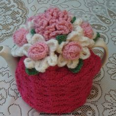 Crochet Tea Cosy with flowers.