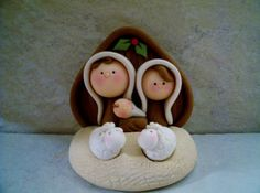 A sweet and simple nativity set that includes Joseph, Mary, tiny baby Jesus, the stable and two little sheep. The figures have been secured