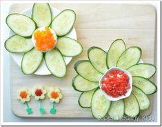 Cucumber flowers with pepper yogurt cheese spread