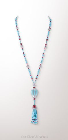 Van Cleef & Arpels Lanterne long necklace, Palais de la chance collection- White gold, diamonds, pink sapphires, rubellites and turquoise. The Lanterne long necklace from the Palais de la chance collection is adorned by an exceptional sculpted turquoise of a perfectly homogeneous blue color at its center. This creation depicts the festival of Lights in China, a celebration marking the end of the Chinese New Year festivities.