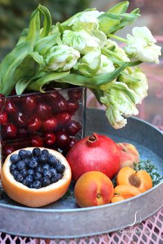 Cherry Decoration | Place a glass of water in a vase, surround with cherries and add flowers for a seasonal centerpiece