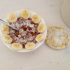 Overnight oats with cacao, coconut, banana and roasted hazelnuts. Rice cake with mashed banana, peanut butter and cream cheese.