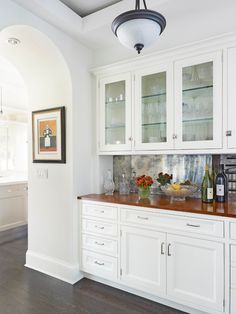 Kitchen Trends for 2013 - Traditional Home® Love this look for a butler's pantry: antique mirror backsplash, wood counters, white cabs w/ glass fronts