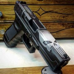 Punisher Glock If guns are your thing perhaps a simple bit of paint can help give it that custom style and look that is required. Custom Glock, Custom Guns, Weapons Guns, Guns And Ammo, Punisher, Revolver, Rifles, Armas Airsoft, Fire Powers