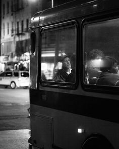 "Photographer Travis Huggett chronicles nocturnal bus commuters in his series ""Last Night at the Bus Stop"""