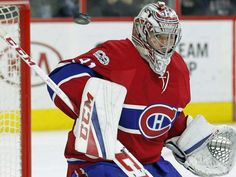 The puck flies past Montreal Canadiens' Carey Price during the second period of the team's NHL hockey game against the Philadelphia Flyers, Thursday, Feb. 2, 2017, in Philadelphia. The Flyers won 3-1. (AP Photo/Tom Mihalek)