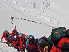 The line waiting to make the summit of Mt. Everest. Very soon will be the Hillary Step where many climbers have met their maker.