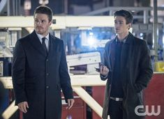"""Arrow -- """"The Scientist"""" -- Image AR208b_0343b -- Pictured (L-R): Stephen Amell as Oliver Queen and Grant Gustin as Barry Allen -- Photo: Cate Cameron/The CW -- � 2013 The CW Network. All Rights Reservedpn"""