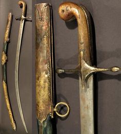 Ottoman kilij, 19th century, curved 78.7 cm (31 in.) single edged blade. Brass crossguard of characteristic form. Horn gripscales, the silver sidestraps chased with florals. Green leather-covered scabbard, the brass mounts chased with floral borders.