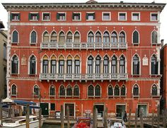 The façade of Palazzo Bembo on the Grand Canal in Venice