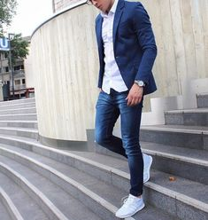 Shop this look on Lookastic: https://lookastic.com/men/looks/white-long-sleeve-shirt-navy-skinny-jeans-grey-athletic-shoes/21113 — White Long Sleeve Shirt — Navy Skinny Jeans — Grey Athletic Shoes