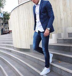 Shop this look on Lookastic: https://lookastic.com/men/looks/white-long-sleeve-shirt-navy-skinny-jeans-grey-athletic-shoes/21113   — White Long Sleeve Shirt  — Navy Skinny Jeans  — Grey Athletic Shoes