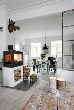 beautiful rustic decor; the raised wood stove is very unique. What a modern feel.