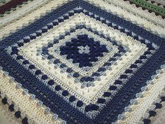 This big and bold crochet lap throw pattern is perfect for keeping you warm on cool evenings without being too heavy.
