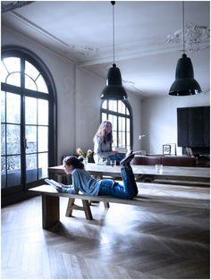 Beautiful apartment with large windows and polished herringbone floor