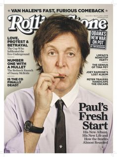Paul McCartney - March 1, 2012 - it's a tiny harmonica! - I had to take a second look -