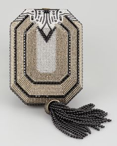 Judith Leiber Joia Octagon Minaudiere Shapely Judith Leiber clutch features  a swinging tassel to add movement to its structured design. 4642b530c2657