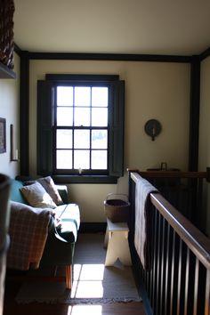 upstairs hall...love the shuttered window and inside corner trim.