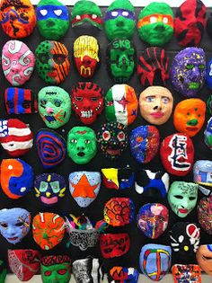 Masks!! I think that this could be one of my favorite projects of all time, the students really love getting involved, working on plastering each other faces and then finally getting to paint them.  Here are some of the faces from 2nd semester. - Art @ Massac: 7th Grade