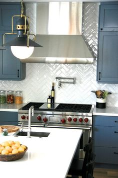 Herringbone backsplash!  transitional kitchen by Von Fitz Design