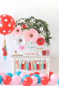 Floral Meets Fawn-inspired Kids Party Ideas - love these crepe paper flowers, rustic decor and bright colors!