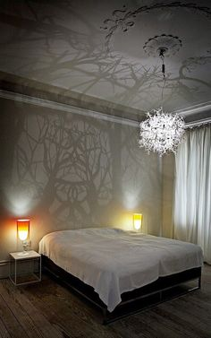 Also a neat idea, Instead of wall paper, have a hanging light create the shadows that look like trees!
