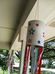 One day at a time- Tin Can Wind Sock. A great repurpose of a tin can turned into a festive and fun 4th of July Party decoration.