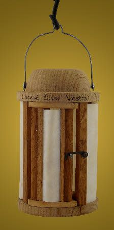 Wooden lantern with parchment panels. The original would have had horn panels, but parchment provides an acceptable alternative when budgets are restricted. Based on an example recovered from the Mary Rose and dated to 1545.