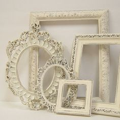 Vintage frames painted white. The finishing touch in a #ShabbyChic #bedroom.