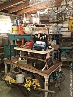 Rusted Roots Junk Shop Like the idea of stacking tables. Could do this along back wall and have shelves around it.