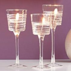 Perfect for weddings and special occasions, our pulled stem glass holders feature a drizzled glass effect on the exterior. For use with votives and tealight #candles #partylite
