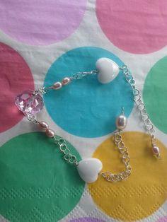 ann wei design sølv armbånd med ferskvandsperler lyserøde, hjerte og lyserød swarowski sten - se mere på www.annweidwsign.dk