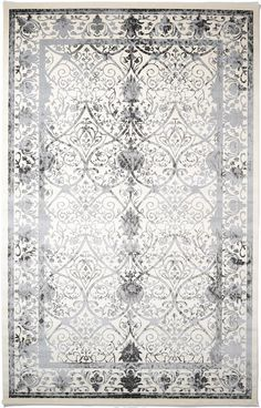 "This Turkish Vista rug is made of Polypropylene. This rug is easy-to-clean, stain resistant, and does not shed.  Colors found in this rug include: Ivory, Black, Brown, Gray. The primary color is Ivory.  This rug is 1/2"" thick."