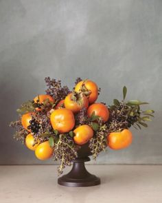 A pairing of vivid persimmons with dusky berries is easy on the eyes and your budget